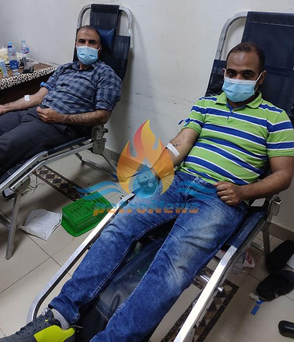 لقطة لمشاركة العاملين أثناء التبرع بالدم